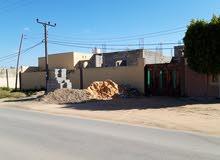 منزل على طريق الرئيسي