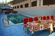 فندق للبيع - جبل الحسين ممكن قبول جزء اراضي اوعقار