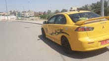 Automatic Yellow Mitsubishi 2010 for sale