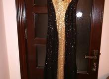فستان سهره اللون اسود وذهبي لبسة واحدة فقط