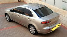 Automatic Gold Mitsubishi 2013 for rent