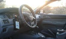 ميتسوبيشي لانسر 2011GLx فحص للبدل أو البيع