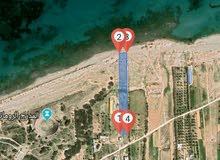 ارض للاستثمار في الخمس علي البحر منطقة باركو الساحل