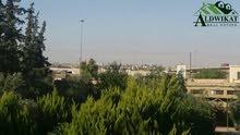 مزرعة للبيع في ام العمد - طريق المطار , مساحة الارض 10200 م مساحة البناء 200 م