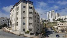شقة في منطقة الخزنة - خلف مستشفى الملكة علياء مباشرة.