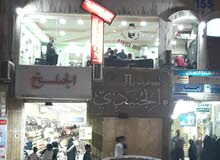 محل تجاري للبيع في الهاشمي الشمالي (( الشارع الرئيسي وسط السوق )) بسعر مميز