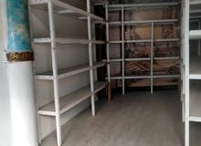 for rent shop in Diraz with some decor and shelves