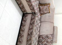 sofa with table and curtains