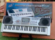 اورجج بيانو جديد مسكر بالكرتونه مكفول محل 250 لحن 61 مفتاح
