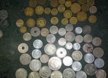 مجموعة عملات معدنية قديمة لدول مختلفة