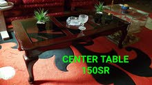 Center/Coffee table from homecenter of wood and glass.