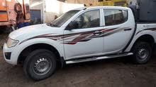 Renting Mitsubishi cars, Pickup 2014 for rent in Muscat city
