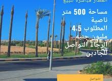 أرض 500 متر ناصية علي المطار الرئيسي مباشرة للبيع