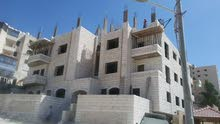 شقة ارضية 150 م مع ترس مميزة للبيع بالاقساط في طبربور قرب دوار الدبابة