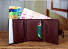 Trifold wallet with pop up card holder