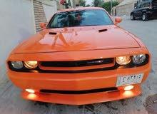دوج جالنجر موديل 2014 اللون برتقالي  مميز  السعر 150