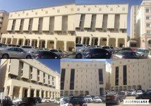 مبنى تجاري في روي في الحي التجاري مقابل البنك المركزي