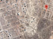 ارض سكنيه مربع ق ثمريت مساحه 913 م بالقرب من استراحه ثمريت الملكيه وبيوت قائمه والمخطط القديم