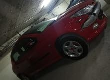 بيجو 206 لون احمر السقف اسود موديل 2008