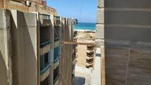 شقة بزهراء الهانوفيل أمام قرية المعمورة