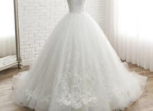 فستان عروس جديد(مو ملبوس لون ابيض )