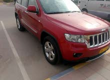 Red Jeep Grand Cherokee 2011 for sale