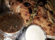 اسطي بيتزا و مقلوبة ابحت عن عمل داخل طرابلس
