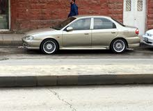 For sale 1999 Grey Sephia