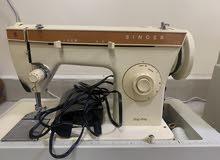 Singer-tailoring device