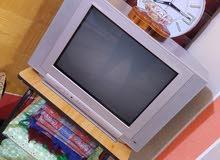 ستائر جديده مع جهاز تلفزيون