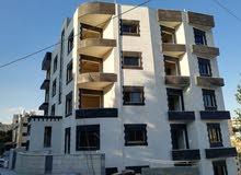 شقة فاخرة اقساط في ضاحية الرشيد((خلف الكلية العلمية الاسلامية)) ومن المالك مباشرة