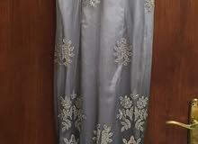 فستان رمادي مع جاكيت