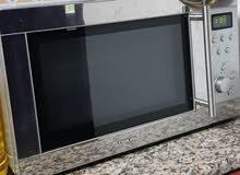 Nikai microwave oven with grill 28 litres digital ميكروويف نيكاي 28 لتر بالشواية ديجيتال