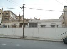 مبنى مكون من 4 شقق ارضية للبيع (حي رمزي)