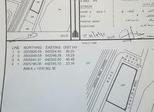 للبيع ارض سكنية في بوشر المنى 1000م2 بواجهة  عريضة مقابل نادي غلا للغولف
