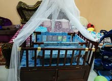 new baby bed consists of  two parts small and big with beautiful color and white shaith.