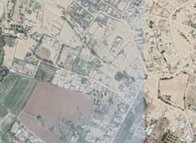 قطعة ارض في منظقة ابوروية