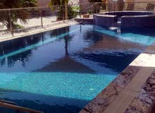 ADoMS GLOBAL لتصميم وإنشاء أحواض السباحة والشلالات