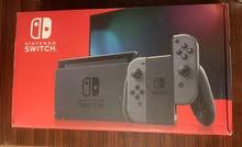 Nintendo Switch (V2) with Gray Joy-Con
