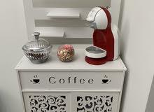 ماكينة قهوة مع ركنة للقهوة