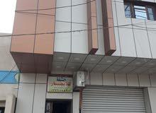 بناية طابقين في حي الحسين الشارع العام موقع تجاري