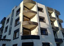 شقة ارضية للبيع في ضاحية الرشيد ومن المالك مباشرة