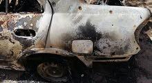 سيارات محروقة متضررة من الحرب   ....
