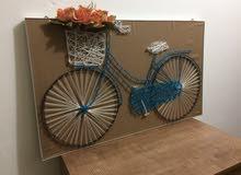 لوحه دراجه هوائه مع باقه ورد قياس 50*85