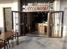 مطعم بيتزا بكافة معداته شغال 100%