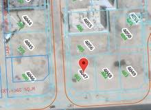 للبيع ارض سكنية كورنر في العامرات الثانية على شارع قار