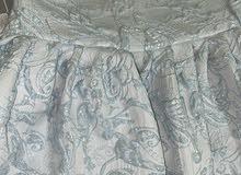 فستان جمسل بلون ازرق فاتح من تصميم منى المنصوري