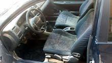 Mazda 323 made in 1998 for sale