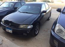 Mazda Fmilia 1998 - Manual