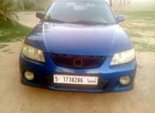 Blue Mazda 323 2000 for sale